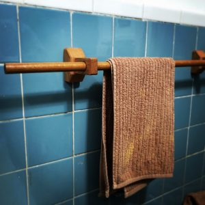 This bathroom towel rack made from oak is custom made and one-of-a-kind